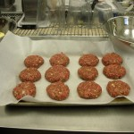 Burger patties ready to be fired up on the grill